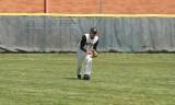 adam plays a ball in left field