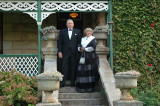 Essex and Janet Barrett on the steps of their home