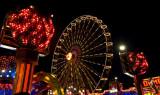 Ferris wheel seen through another ride