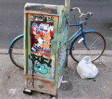 Bicycle by a News Box