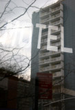 Motel Sign  with Window Reflection of LaGuardia Place Residences
