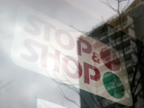 STOP & SHOP Sign  with Window Reflection of LaGuardia Place Residences