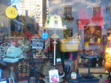 Thrift Shop Window with Reflection of MacDougal Mews