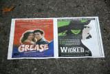 Grease & Wicked Paper Ads on Park Path