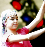 young girl performs oriental dance