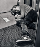 Sleeping in the foyer of a bank agency