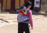 Mother carry her baby
