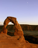 Delicate Arch at Sunset with the rising moon vertical.jpg