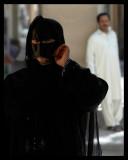 Woman wearing traditional mask - Nizwa