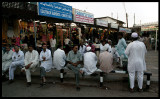 Men gathering at the market place - Mutrah