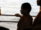 Young Buddhist Monk Deep in Thought on the River Bus