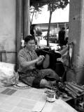 Street Cobbler Happy in his Work