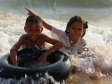 Brother and Sister Playing in the Surf at Jomtien Beach