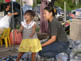 Little Girl Dancing to the Radio at a Pathum Thani Market
