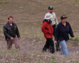 zP1000511 Two BFC women escorted away from capture facility conversation.jpg