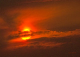 zP1010446 Wildfire-tinted sun at Lake Five near West Glacier Montana.jpg
