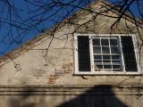 Exposed brick black shutters blue sky - nice.jpg
