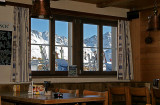 View trough a window of a moutain restaurant