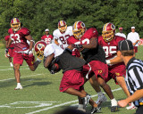#26 Clinton Portis - Still on his feet but losing the shorts