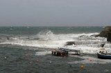 an extra high tide and inshore wind