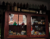 chemist's cabinet - apparently a 'time-warp' as created in 1929