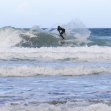 surfing at Porthtowan in difficult cross breakers at low tide