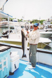 Andy with a large striped bass , Block Island 2007 001.jpg