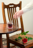 She put her glass on the small table beside the chair and rose.