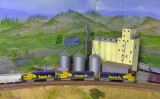 Passing the grain silo in a corner of the layout