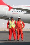 1527 4th October 06 Ramp Drivers Sharjah Airport.JPG