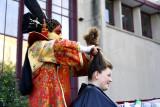 Alex does Gabrielle's hair