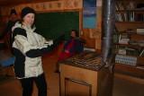 Snowshoer  Sam Warming Up In Old Stehekin Log School