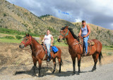 Young Couple Ride Their Horses Down  Sleepy Entiat River Road