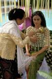 Javanese bride undergoes the Midarodeni or washing ceremony