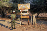 Guard with signpost at Mvuu Camp,  Liwonde National Park