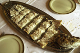 Baked sea bass served at table (Galicia)