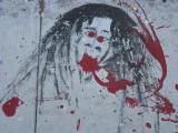 Bloody Jesus on the Sidewalk