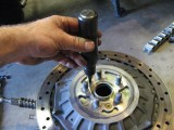 You need an impact wrench to remove the screws on the rotor