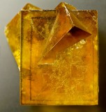 Amber-coloured transparent fluorite penetration twin, 22 mm on edge, Hilton Mine, Scordale, North Pennines, Cumbria, England.