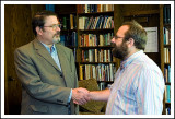 Rabbi Swartz Shaking Hands with Board Member