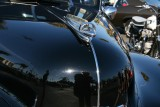 Reflection in hood of this 40 chevy .