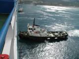 Tugs assisting vessel into drydock.jpg