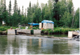 Floating weir and cabin.jpg