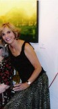 Taken at an art show in Santa Fe that had some of my paintings in it.  The one partially shown in the background is one of mine.