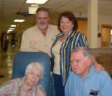 Marilyn with bros. Eugene, standing, and Steve visit her mom