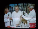 Regis gets a flu shot