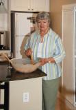Ann Peralta stirring up the salad at John's dinner