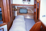 aft cabin berth, note port in hull, strbd aft