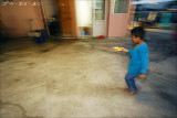 little boy going around the temple