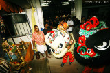 Chinese lion dance troupe invited by Chinese temples nearby